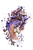 Crushed eyeshadow  on white. Crushed bronze and purple eyeshadow  on white Stock Photo