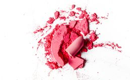 Crushed eyeshadows, lipstick and powder isolated on white background. Beauty texture, cosmetic product and art of make-up concept - Crushed eyeshadows, lipstick royalty free stock photo
