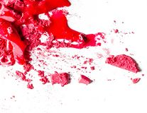 Crushed eyeshadows, lipstick and powder  on white background. Beauty texture, cosmetic product and art of make-up concept - Crushed eyeshadows, lipstick and royalty free stock photography
