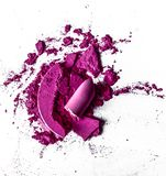 Crushed eyeshadows, lipstick and powder isolated on white background. Beauty texture, cosmetic product and art of make-up concept - Crushed eyeshadows, lipstick royalty free stock photos
