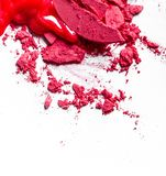 Crushed eyeshadows, lipstick and powder isolated on white background. Beauty texture, cosmetic product and art of make-up concept - Crushed eyeshadows, lipstick stock images