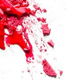 Crushed eyeshadows, lipstick and powder isolated on white background. Beauty texture, cosmetic product and art of make-up concept - Crushed eyeshadows, lipstick stock photo