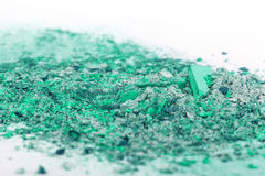 Crushed eyeshadows on white background Royalty Free Stock Photos