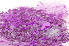 Crushed eyeshadows on white background Royalty Free Stock Photography