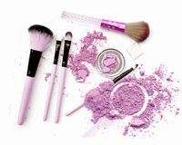 Crushed facial purple eyeshadow on white background. Stock Images