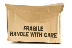 Crushed Fragile Box. A crushed cardboard box with Fragile Handle With Care printed on it. On a white background Royalty Free Stock Photo
