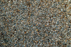 Crushed granite gravel filling cement surface as background texture Stock Photos