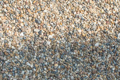 Crushed granite and pebble gravel texture.  Stock Image