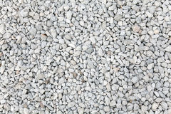 Crushed gravel. White small rocks Stock Photography