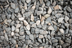 Crushed gravel stone on the ground texture background Stock Image