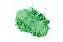 Crushed green eye shadow isolated on white background royalty free stock photo