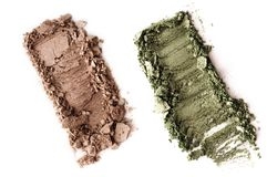 Crushed green eyeshadow isolated on white. Background Royalty Free Stock Image