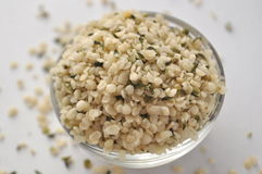 Crushed Hemp hearts or seeds - natural and nutritious dietary supplement suitable for vegans. Vegetarians, raw foodists and allergy sufferers, in a glass bowl Royalty Free Stock Photos