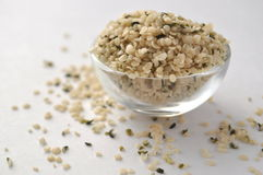 Crushed Hemp hearts or seeds - natural and nutritious dietary supplement suitable for vegans. Vegetarians, raw foodists and allergy sufferers, in a glass bowl Royalty Free Stock Image