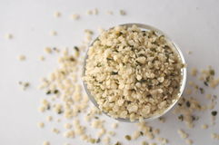 Crushed Hemp hearts or seeds - natural and nutritious dietary supplement suitable for vegans. Vegetarians, raw foodists and allergy sufferers, in a glass bowl Stock Photos