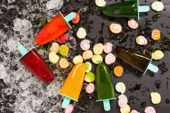 Crushed ice cubes and homemade ice cream on vintage black wooden. Table. Top view Stock Photo