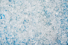 Crushed ice cubes on vintage blue wooden table. royalty free stock image