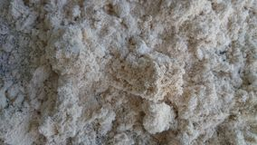 Crushed limestone pieces background and texture. Limestone chips and iron that crumble at eating age Pile of lime cough background and texture. This image is a stock photography