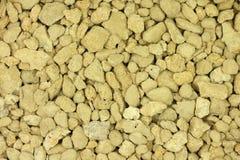 Crushed limestone yellow background Royalty Free Stock Photos