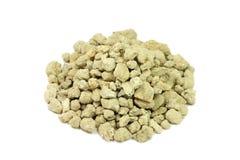 Crushed limestone yellow. On a white background Stock Photo