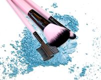 Crushed makeup eyeshadow and brush on white background. The eye shadows Royalty Free Stock Photo
