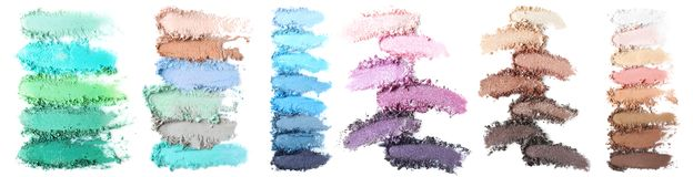 Crushed makeup products on white background. C royalty free stock photography