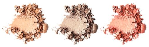 Crushed makeup products on white background. stock images