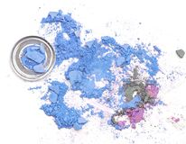 Crushed makeup on white background. The eye shadows stock photos
