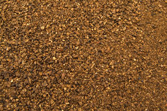 Crushed malt grains fermenting close up. Crushed brown malt grains fermenting close up Royalty Free Stock Images