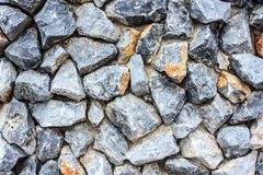 Crushed natural stone wall background Royalty Free Stock Image