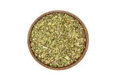 Crushed oregano leaves in a wooden bowl Stock Photography