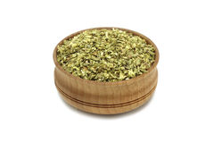 Crushed oregano leaves in a wooden dish Royalty Free Stock Images