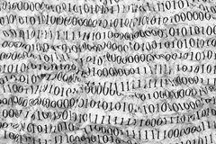 Crushed paper with binary code Royalty Free Stock Images
