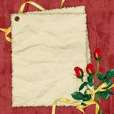 Crushed paper with roses on the red background. Crushed paper with roses and ribbons on the red background Stock Photography