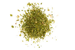 Crushed Parsley. Dried, crushed parsley flakes isolated on white royalty free stock images