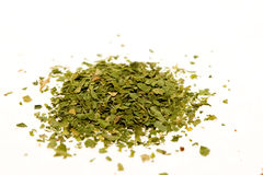 Crushed Parsley. Dried, crushed parsley flakes isolated on white royalty free stock photography