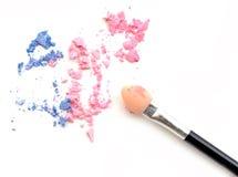 Crushed pastel tone eyeshadows with brush isolated on white background. Crushed pastel tone eyeshadows with brush isolated on white background Royalty Free Stock Image
