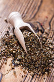 Crushed Peppercorns on a wooden spoon Stock Photography