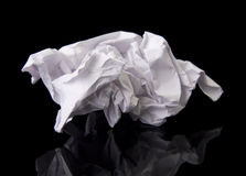 Crushed piece of paper. With reflection. Isolatein on black royalty free stock photo