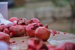 Opened pomegranates. Crushed pomegranates compressed pomegranate. pomegranate isolated on nature background stock image