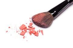Crushed powder blush orange color with makeup brush Royalty Free Stock Image