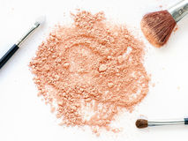 Crushed powder with make-up brushes royalty free stock image