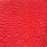 Crushed red paper texture Stock Images