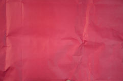 Crushed red paper texture. Red background Stock Photos