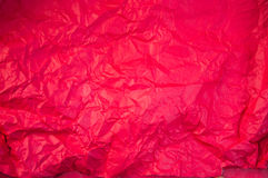 Crushed red paper texture. Red background Stock Image