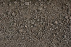 Crushed rock path. Crushed rock or broken stone of a metalled agricultural road, showing the distinctive texture of the crushed rock forming the surface of the Stock Photo
