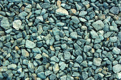 Crushed rocks background. Small gray rugged crushed rocks background Stock Image