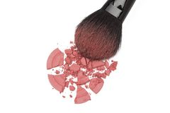 Crushed rouge with makeup brush Stock Photos