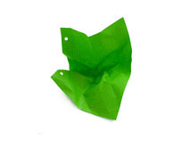 Crushed sheet of paper. Crushed sheet of green lined paper isolated Stock Image