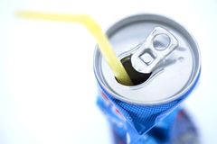 Crushed Soda Can with Straw. Crushed soda can with straw  on white background Stock Photo